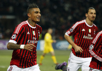 AC Milan's Boateng celebrates after scoring against Arsenal during their Champions League last 16 first leg soccer match at the San Siro Stadium in Milan