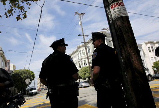 San Francisco police officers stand on Lombard Street in San Francisco