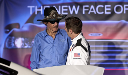 NASCAR legend Petty talks with driver Biffle after Ford announced the new 2013 stock car during the NASCAR Media Tour in Concord