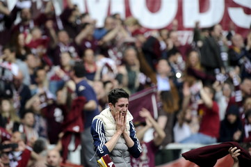 A supporter of Torino reacts after winning their Italian Serie A soccer match against Juventus at Olympic Stadium in Turin