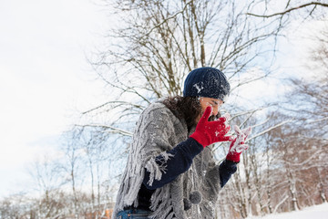 Woman wiping snow out of her face