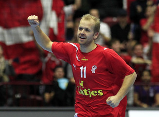Denmark's Eggert celebrates after scoring against Serbia during their group C match at the Men's Handball World Championship in Malmo
