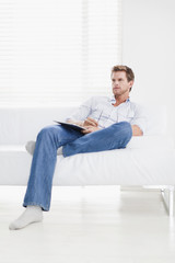 Man watching television on couch