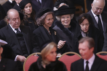 Spain's former King Juan Carlos, Queen Sofia and Princess Beatrix of the Netherlands attend a funeral service for Belgium's Queen Fabiola at Saint-Gudule cathedral in Brussels