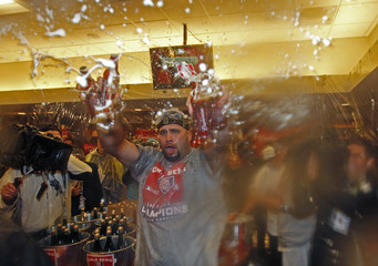 St. Louis Cardinals first baseman Albert Pujols (C) celebrates in the locker room after the Cardinals defeated the Texas Rangers to win MLB's World Series baseball championship in St. Louis