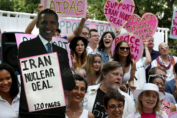 Anti-war activists rally outside the White House in Washington in support of the Iran nuclear deal