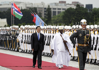 Taiwanese President Ma inspects honour guards with Gambia's President Jammeh during welcoming ceremony at Chiang Kai-shek Memorial in Taipei