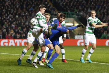 Barcelona's Andre Gomes in action with Celtic's Mikael Lustig