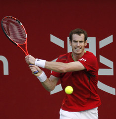 Murray of Britain hits a return to Bogomolov Jr. of the U.S. during the Japan Open tennis championships in Tokyo