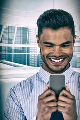Composite image of happy businessman using mobile phone