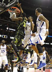Baylor's Miller is fouled by Kansas' Wesley during the semifinals of the NCAA men's Big 12 basketball tournament in Kansas City