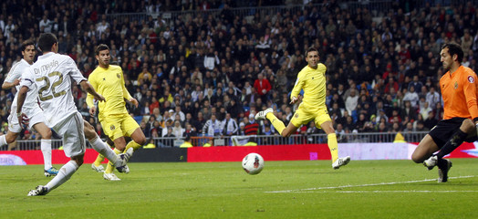 Real Madrid's Di Maria scores a goal past Villarreal's goalkeeper Lopez during their Spanish first division soccer match in Madrid