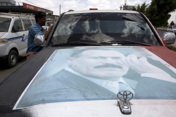 A poster of Yemen's former President Ali Abdullah Saleh is seen on a car in Yemen's capital Sanaa