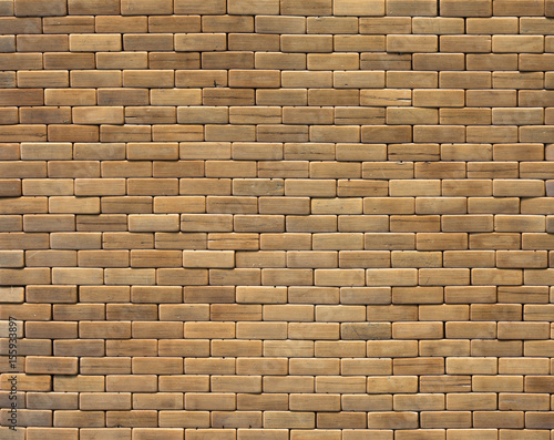 Background of brown wooden bricks Wooden wall made of solid