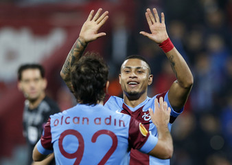 Trabzonspor's Adin celebrates with his team mate Henrique after scoring a goal against Apollon Limassol during their Europa League soccer match in Trabzon