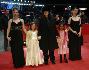 Director Markovitch poses with cast members as they arrive for screening of movie 'El Premio' at Berlinale film festival in Berlin