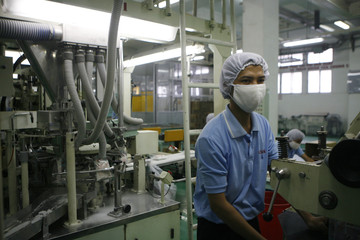 A man works at the Vedan International fermentation based food additive and biochemical factory at Go Dau industry park