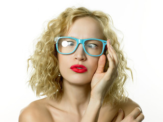 Young woman wearing blue glasses, cross eyed