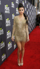 Singer Selena Gomez arrives at the 2013 MTV Movie Awards in Culver City