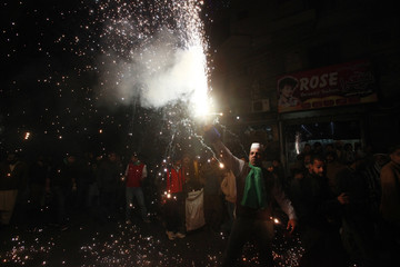 A man holds fireworks during a celebration to mark Eid-e-Milad-ul-Nabi, the birthday anniversary of Prophet Mohammad in Lahore