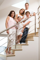Family standing on stairs