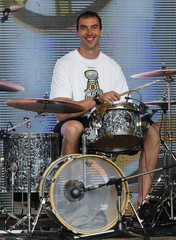 Boston Bruins captain Chara of Slovakia plays drums during Stanley Cup trophy tour in his hometown Trencin