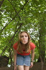 Teenage girl blowing a bubble gum bubble