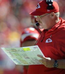 Chiefs coach Reid looks at his playbook during the win over the Giants in a NFL football game in Kansas City, Missouri