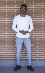 Black man posing white shirt.