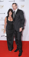 Former German boxer Maske and his wife Manuela arrive for 62nd Bambi media awards ceremony in Potsdam