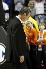 Mississippi State head coach Rick Stansbury heads to the bench after Kentucky tied the game in regulation of the championship game in Nashville