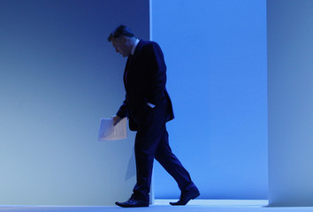 Britain's shadow chancellor Ed Balls arrives to make his speech during the Labour party's annual conference in Brighton
