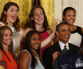 Dolson along with Stokes put bunny ears over U.S. President Obama during a ceremony to honor the team in the East Room at the White House in Washington