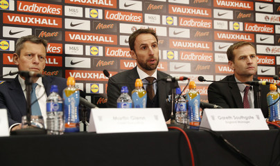 England manager Gareth Southgate, FA Chief Executive Martin Glenn (L) and FA Technical Director Dan Ashworth (R) during the press conference