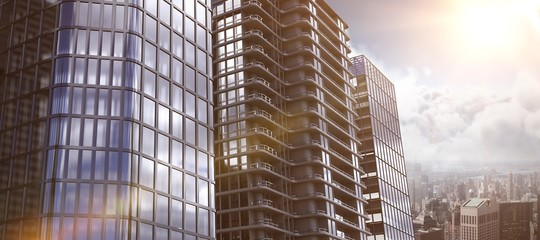 Composite image of 3d image of glass buildings