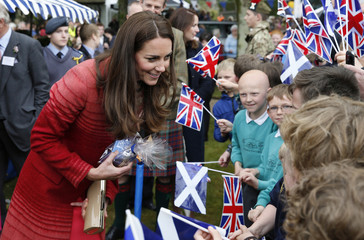 Britain's Catherine, The Duchess of Cambridge, meets community members during a visit to the Forteviot Fete,