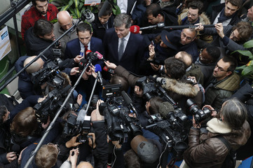 Journalists surround Benoit Hamon, former French education minister and Socialist party candidate in their second-round presidential primary election, and former Socialist primary candidate Arnaud Montebourg as they visit the Pepiniere site in Paris