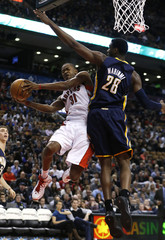 Raptors Ross goes to the basket against Pacers Mahinmi during their NBA basketball game in Toronto