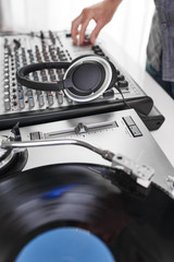 a dj using a turntable and mixing board