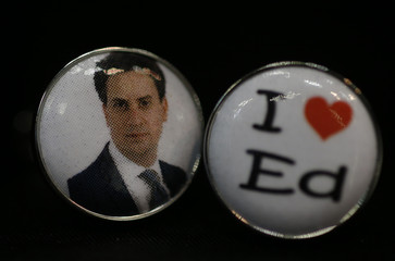 Novelty cufflinks showing a picture of British opposition Labour Party leader Ed Milliband are displayed for sale on a stall on the opening day of the Labour Party annual conference in Manchester