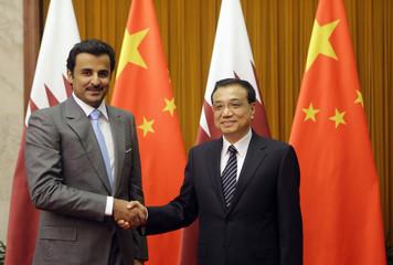 Qatar's Emir Sheikh Tamim bin Hamad al-Thani shakes hands with China's Premier Li Keqiang in Beijing