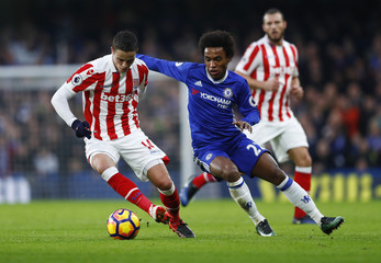 Stoke City's Ibrahim Affelay in action with Chelsea's Willian
