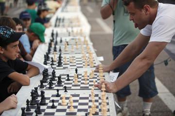 Israeli grandmaster Alik Gershon looks at a board during a  simultaneous chess game in Tel Aviv