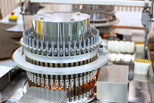 Automatic optical inspection machine, inspects vials and ampules for particulates in liquid and container defects.