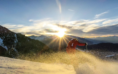 A skier makes a turn during sunset on Rosshutte mountain in the western Austrian ski resort of Seefeld