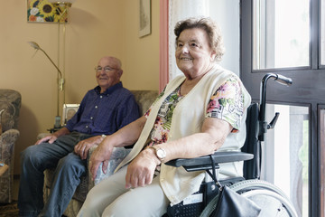 Senior couple spending time in their room in retirement home