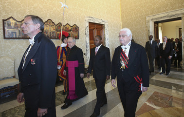 Mozambique's Prime Minister Vaquina walks to meet Pope Francis at the Vatican