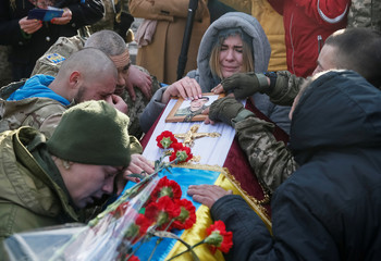 "People take part in a funeral ceremony for servicemen from the ""Aydar"" battalion, who were killed in the fighting in eastern Ukraine, in Kiev"