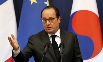 French President Hollande answers a reporters' question during a joint press conference following his meeting with South Korean President Park at the presidential Blue House in Seoul