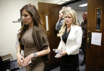 Taya Kyle, wife of slain Navy SEAL Chris Kyle, leaves the Erath County Donald R. Jones Justice Center courtroom following the days proceedings in Stephenville